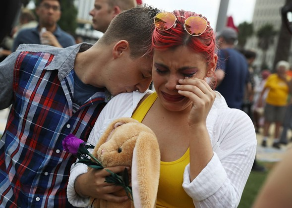 Mourners gather in Orlando Monday. - JOE RAEDLE/GETTY IMAGES