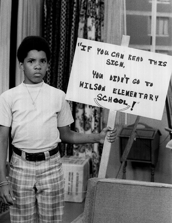 Michael Evans (Ralph Carter) carries a picket sign criticizing the quality of education at his school, in this still from the TV show Good Times. - SUN-TIMES PRINT COLLECTION