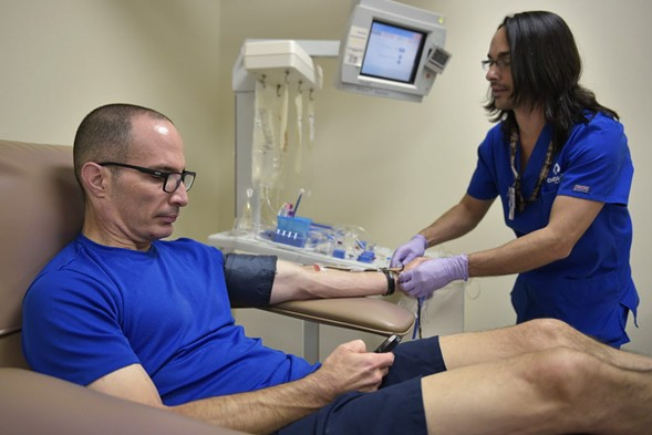 A technician prepares to take a blood donation at a clinic in Orlando. - AFP/GETTY IMAGES