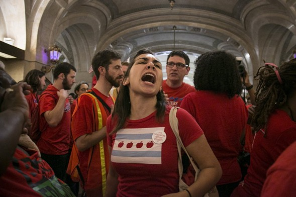 More than 100 members of the Chicago Teachers Union protested at City Hall yesterday. - ASHLEE REZIN/SUN-TIMES