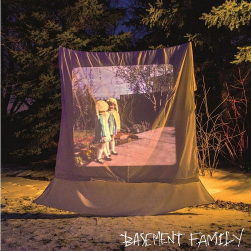 The cover of Basement Family
