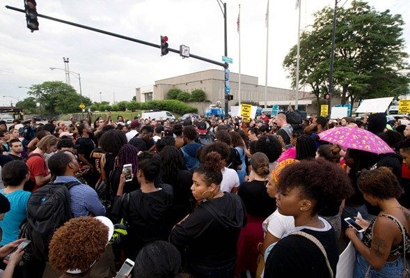 Protestors against police brutality march in front of Police District 2 Station in Chicago. - TASOS KATOPODIS/GETTY IMAGES