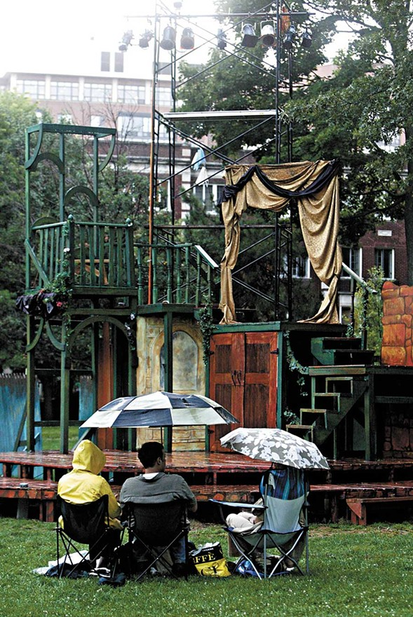 Theatre-goers wait for the rain to stop before the Oak Park Festival Theatre's 2009 production of Cyrano de Bergerac. - SUZANNE TENNANT