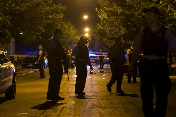 Chicago Police Department officers investigate a shooting. - ASHLEE REZIN/SUN-TIMES