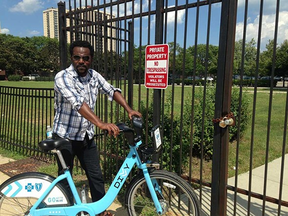 Harris by the locked gate at 29th and Michigan that blocks direct access to Dunbar Park and the lakefront. - JOHN GREENFIELD