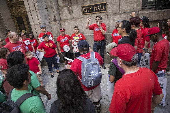 Members of the Chicago Teachers Union rally outside City Hall in July. - RICH HEIN/SUN-TIMES