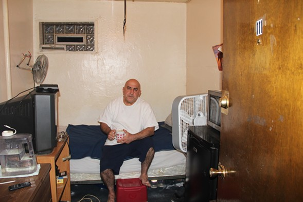 Resident Henri Khodabakhsh says mice and cockroaches are a constant problem in his first-floor room. - KARI LYDERSEN