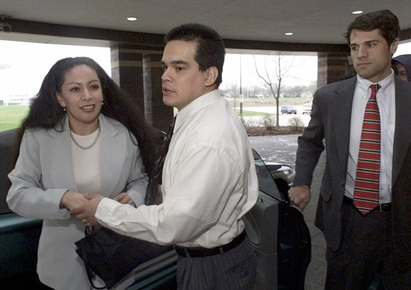 Rolando Cruz, center, in front of the DuPage County Courthouse in 1999 - AP PHOTO/BETH A. KEISER