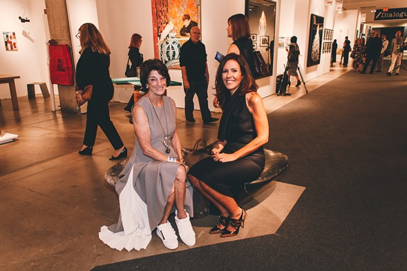 Anne Kaplan (left), in a gorgeous pleated dress with gym shoes, and Sara Albrecht - DANIELLE A. SCRUGGS