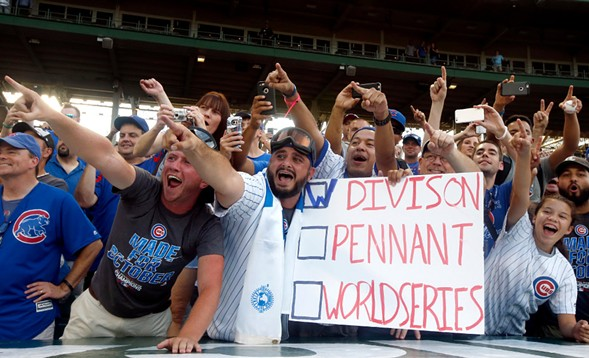 Chicago Cubs fans celebrate the team's NL Central title in September. - AP PHOTO/NAM Y. HUH
