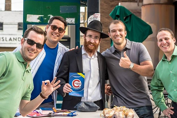 Rabbi Dovid Kotlarsky and Cubs fans in Wrigleyville - COURTESY DOVID KOTLARSKY