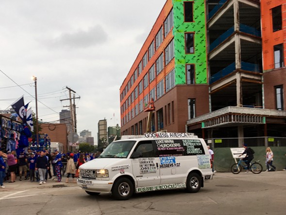 Outside Wrigley Field, a van driven by an acquaintance of Steve the Rebuker evangelized before game two of the NLCS. - AIMEE LEVITT