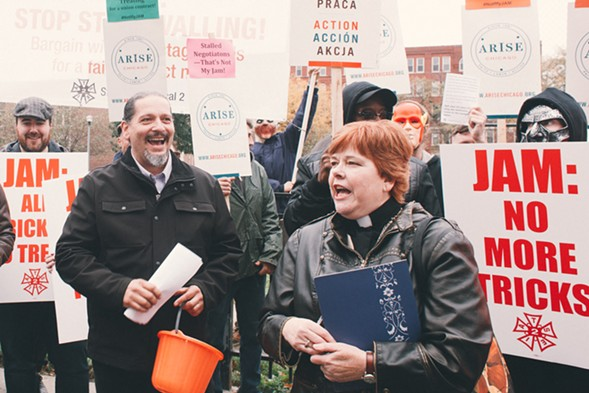 Riviera stagehand Lou Svitek (left) and Arise Chicago executive director C.J. Hawking address the crowd gathered in front of the Jam Productions offices for a Halloween-themed union action. - DANIELLE A. SCRUGGS