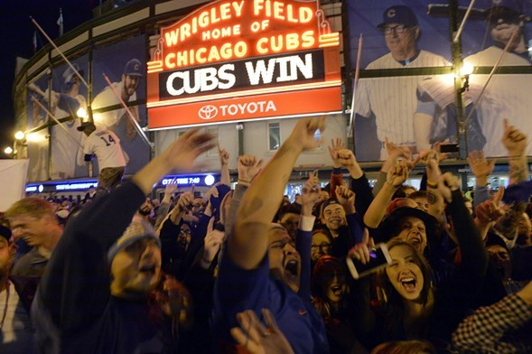 Cubs fans celebrate a victory outside Wrigley Field in 2015. - AP PHOTO/PAUL BEATY