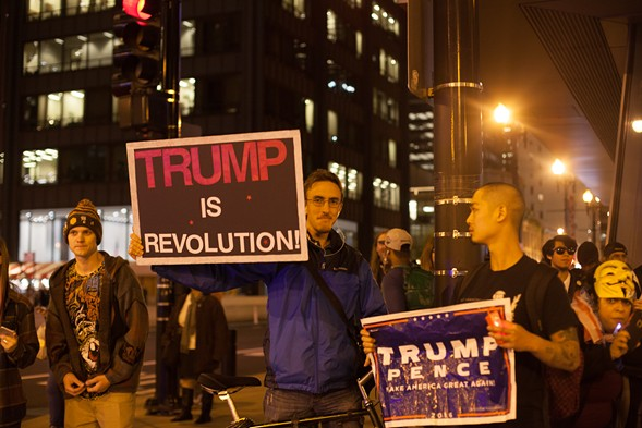 Trump supporters along the parade route - DANIELLE A. SCRUGGS