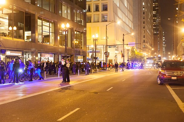 By the time the parade crossed Dearborn, it had spread out enough to fit onto the sidewalk. - DANIELLE A. SCRUGGS