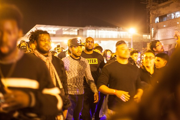 Chance in the thick of the march, with a security staffer who appears to have spotted the photographer - DANIELLE A. SCRUGGS