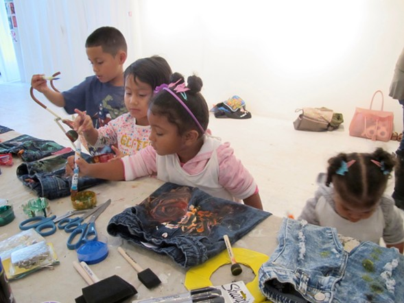 Children painted denim pieces they picked at the Chicago Art Department. - ISA GIALLORENZO