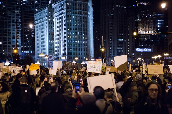 Protesters gather across the river from Trump Tower on the night of November 9. - SARAH K. JOYCE