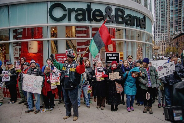 Black Friday demonstrators called for resisting Donald Trump, Rahm Emanuel's resignation, and an elected Civilian Police Accountability Council. - JOSHUA MELLIN