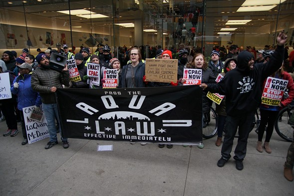 Activists at the Black Friday march also called for the state legislature to pass the Laquan McDonald Act, also known as the Laquan Law. - JOSHUA MELLIN