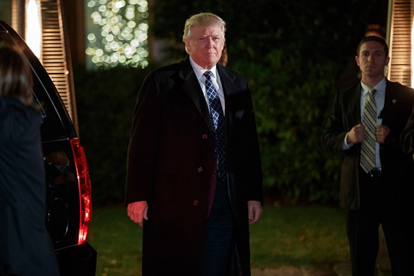 President-elect Donald Trump looks toward reporters as he arrives for a party at the home of Robert Mercer, one of his biggest campaign donors, Saturday. - AP PHOTO/EVAN VUCCI