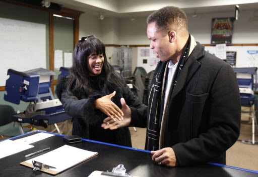 Former U.S. rep Jesse Jackson Jr. and former alderman Sandi Jackson ask each other for their votes as they arrive at a polling station in 2012. - AP PHOTO/M. SPENCER GREEN