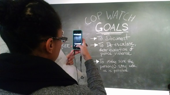 In a classroom at the School of the Art Institute, the People's Response Team recently held a workshop on the monitoring of interactions between citizens and police officers. - MAYA DUKMASOVA