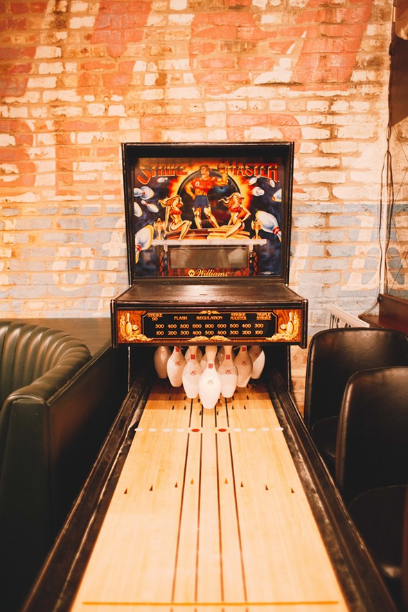 A shuffleboard-style bowling game in the back of the bar - DANIELLE A. SCRUGGS