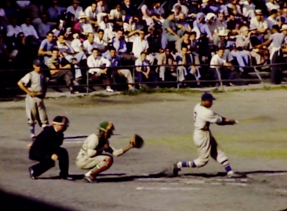 A still from the 2016 Media Mixer film What's The Matter With Kids Today, made by Andrew Mausert-Mooney and Bobby Conn; the original archival footage was repurposed by the artists from the film 1942 Circa: Chicago Cubs Game - Train Ride - Baby, from the Baker Collection. - CHICAGO FILM ARCHIVES