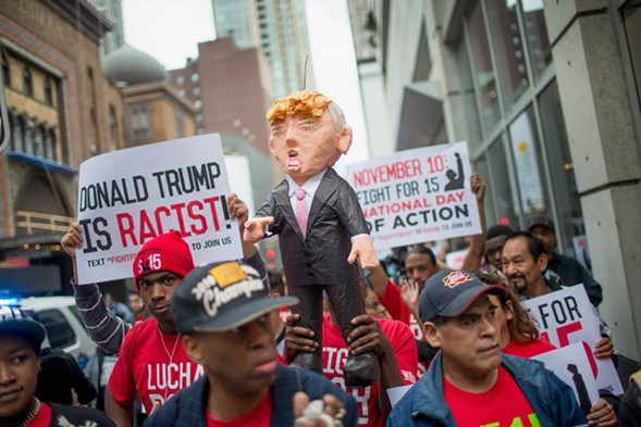 Demonstrators marched through downtown in mid-October, then held a rally in front of Trump Tower calling for immigration reform and fair wages. - SCOTT OLSON/GETTY IMAGES