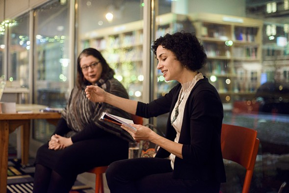 Emily Lordi (right) reads from her book on soul singer Danny Hathaway during a discussion with Tara Betts at the Seminary Co-op. - LUKE SIRONSKI-WHITE