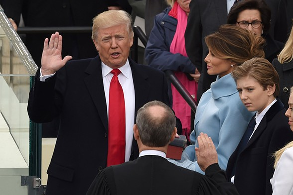 The Cat in the Hair Hat takes the oath of office. - GETTY
