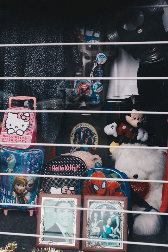 Photos in the window of Viking Beauty Supply on Hyde Park Boulevard