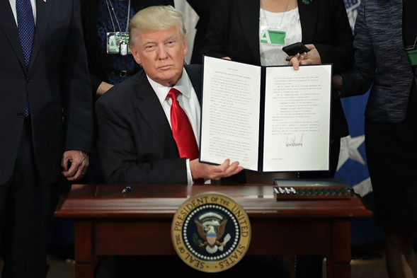U.S. President Donald Trump displays one of the four executive orders he signed Wednesday. - PHOTO BY CHIP SOMODEVILLA/GETTY IMAGES