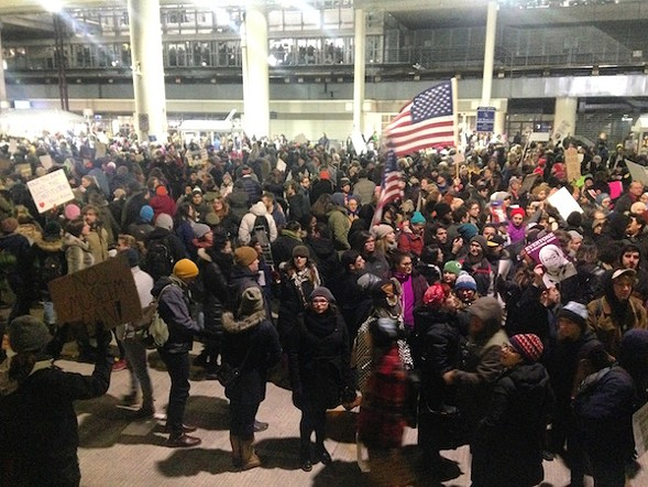 Thousands of people gathered outside O'Hare's Terminal 5 Saturday evening to protest President Trump's ban on travelers from seven Muslim-majority countries, including Iran, Iraq, Syria, and Libya. - PHILIP MONTORO