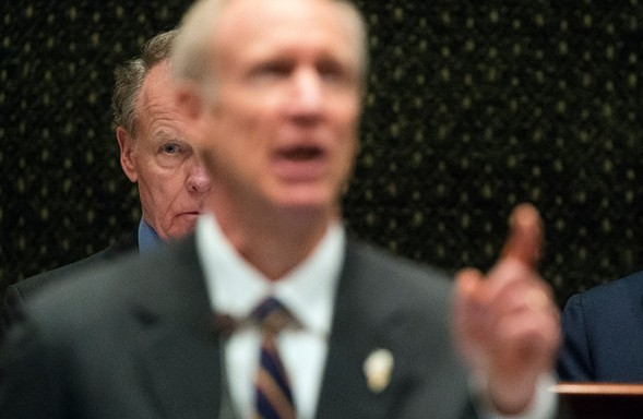 Illinois house speaker Michael Madigan listens as Governor Bruce Rauner delivers his State of the State address. - TED SCHURTER/THE STATE JOURNAL-REGISTER VIA AP