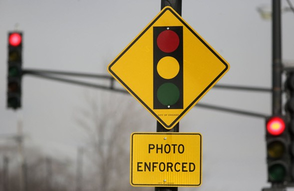 A sign warns motorists of the presence of a red-light camera in Chicago. - AP PHOTO/M. SPENCER GREEN
