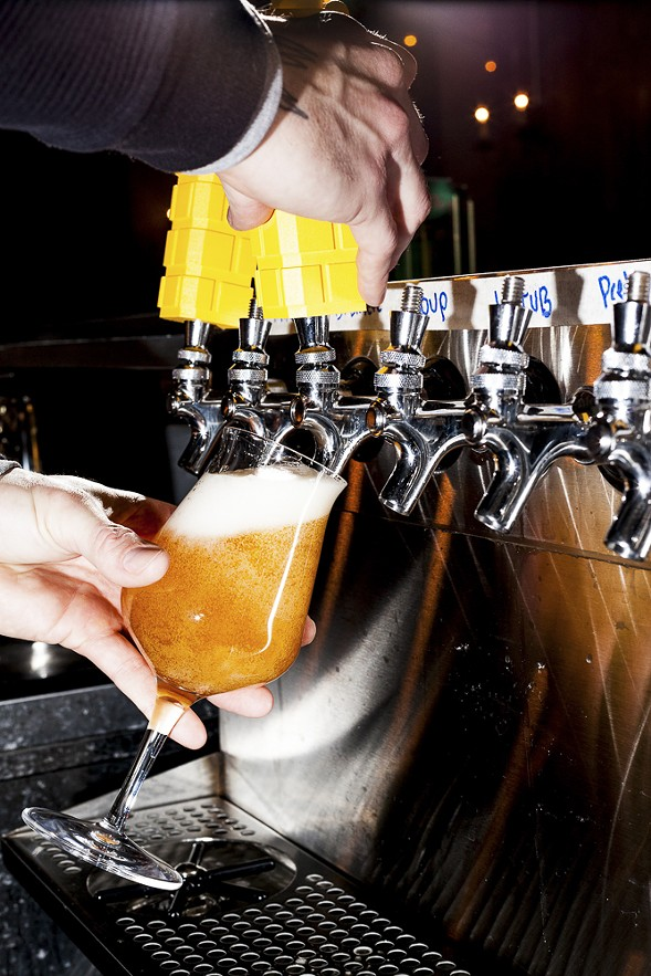 Bright yellow tap handles pour a variety of beer from Whiner. - NICK MURWAY
