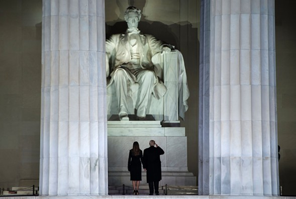 Then President-elect Donald Trump and wife Melania gaze up at the Lincoln Memorial on the eve of Trump's January Inauguration. - BRENDAN SMIALOWSKI/AFP/GETTY IMAGES
