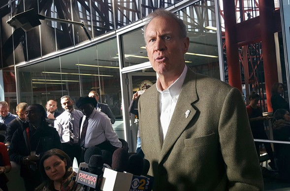Illinois governor Bruce Rauner speaking with reporters at the Thompson Center - AP PHOTO/SOPHIA TAREEN