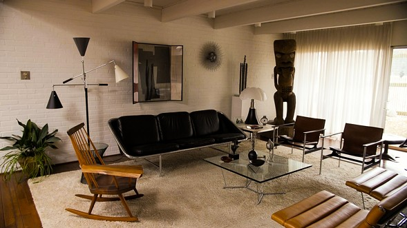 "A view of the Carters' living room. ""We have a few tikis that are too big to fit downstairs,"" David says. - KERRI PANG"