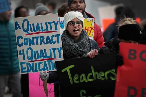 Unionized teachers with Aspira rallied outside one of the charter network's high schools March 9 to try to convince the company to come to terms on a contract. - SCOTT OLSON/GETTY IMAGES