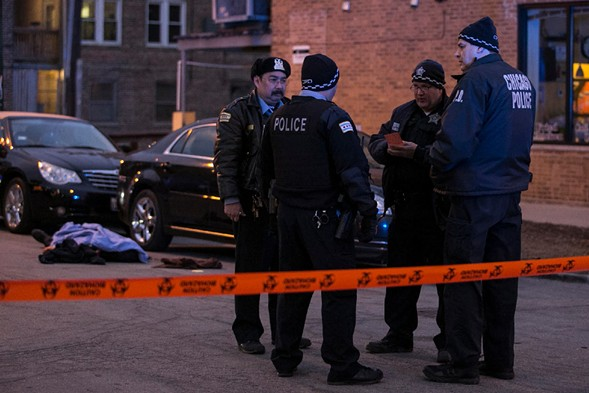 Four Chicago police officers investigating a shooting in February. - ASHLEE REZIN/SUN-TIMES