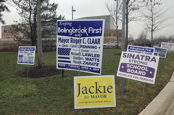 Campaign signs for the Bolingbrook mayoral race littered the lawn outside the Fountaindale Public Library  earlier this week. - AP PHOTO/SARA BURNETT