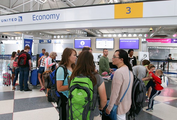 Customers wait in line in United Airline's Terminal 1 at O'Hare International Airport in 2015. - TIM BOYLE/FOR THE SUN-TIMES