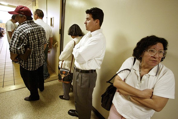 Patients wait in line for treatment at a California clinic. - AP PHOTO/DAMIAN DOVARGANES/FILE
