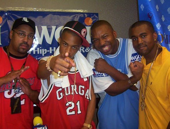 """Bad Boy Radio hosts Victor """"the Dizz"""" Blackful (far left) and Mike Love (in blue) with T.I. and Kanye West in 2003 - COURTESY OF MIKE LOVE"""