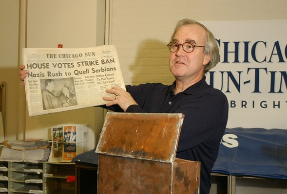 Former Chicago Sun-Times publisher John Cruickshank, shown here in 2004, holds up a copy of the first edition of the Chicago Sun newspaper, dated December 4, 1941. - JOHN J. KIM/SUN-TIMES