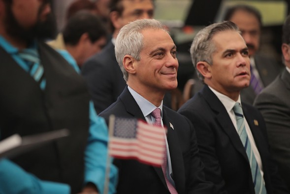 Mayor Rahm Emanuel and Mexico City mayor Miguel Mancera watch as citizens are sworn in during a naturalization ceremony. - PHOTO BY SCOTT OLSON/GETTY IMAGES